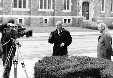 The late John Chancellor (right) hosted and narrated the first three Eisenhower television specials. At West Point, in 1996, Colburn directs cameraman Vince Gancie as Chancellor waits for his cue.